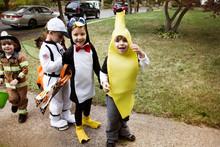 Portrait Of Children (4-5) Wearing Costumes On Halloween
