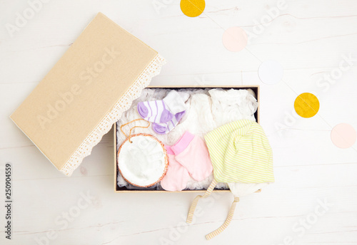Fotomural Vintage keepsake box for preserving baby`s first clothes and things concept