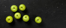 Top Down View, Green Apples On Dark Marble Board. Healthy Food With Fruit Banner, Space For Text On Right.