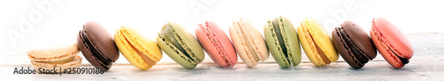 Photo sur Toile Macarons Sweet and colourful french macaroons or macaron on white background