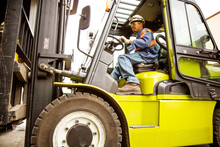 Manual Worker Driving Forklift