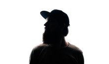 Bearded Man Portrait Silhouette In Backlight. Handsome Bearded Mna Looking Away On White Background