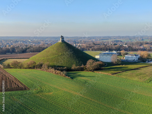 Aerial view of The Lion's Mound with farm land around Canvas-taulu