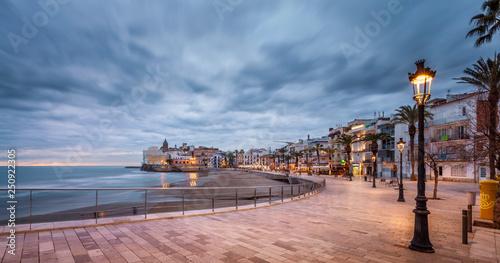 Stickers pour portes Saumon beach walk at sunset in playa san sebastian Sitges catalunya spain