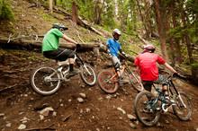 Mountain Biker Riding On Footb...