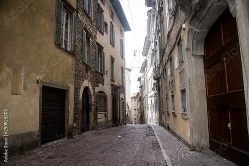 Acrylic Prints Narrow alley Street of the old city of Bergamo . Italy .