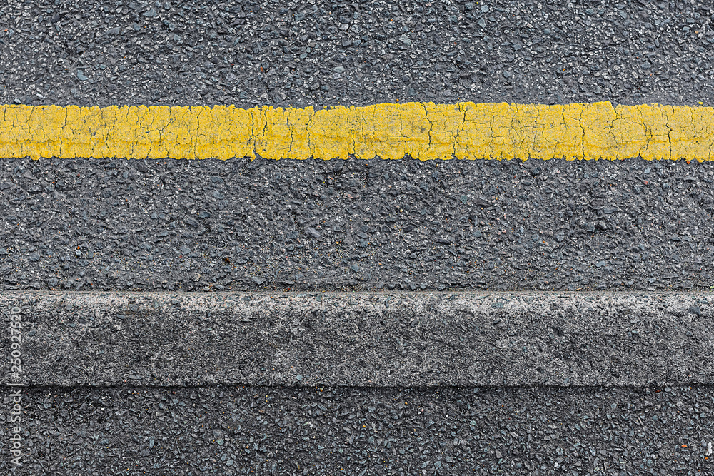 Fototapeta Seamless roadside curb with a single yellow line from above.