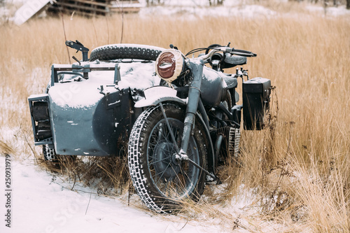 Fototapety, obrazy: Old Tricar, Three-Wheeled Motorbike Of Wehrmacht, Armed Forces Of Germany Of World War II Time In Winter Forest