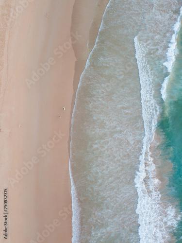 Wall Murals Air photo Top down aerial view of clean beach coastline.