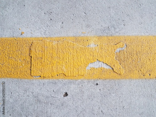 yellow painted line on grey cement surface