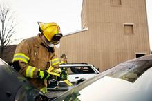 Female Firefighter Cutting Cra...