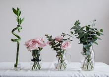 Roses And Bamboo On Table