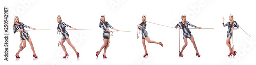 Foto Woman sailor in tug of war concept