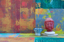 Red  Buddha And Blue Bowl