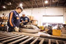 Men Working At Factory