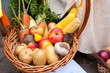 Autumn harvest: basket with vegetables and fruits, potatoes, apples, beets, garlic, corn, carrots