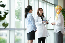Doctor Talking With Patients I...