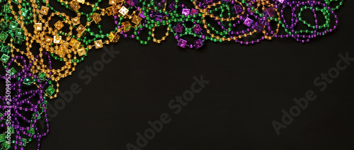 Photo Purple, Gold, and Green Mardi Gras beads background