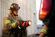 Firefighter Using Flashlight O...