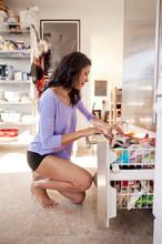 Woman Looking Through Freezer