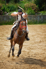 Man Riding Horse While Shooting Bow And Arrow