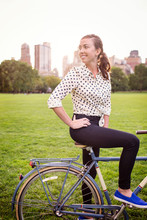 Young Woman With Bicycle In Central Park