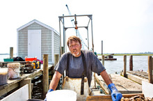 Oyster Fisherman On Dock With ...