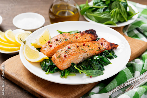 Salmon fillet with spinach . Tableau sur Toile