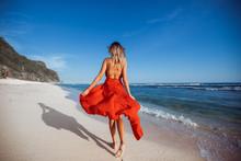 Girl Walking On The Beach In R...