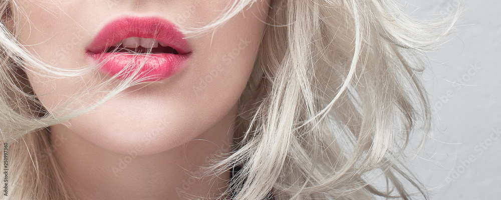 Fototapety, obrazy: Close-up red plump lips of a young blonde woman on a white background. Cosmetology and plastic surgery banner