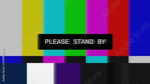 Fotografía  A tv transmission, noisy distortion signal of SMPTE color bars (tv screen test pattern) with the text: Please stand by