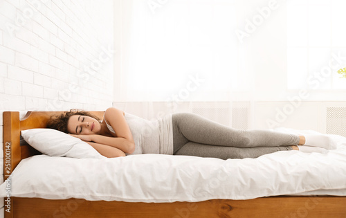 Fotografie, Obraz  Beautiful young woman sleeping lying in her bed