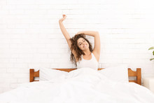Smiling Woman Waking Up In Her Bed