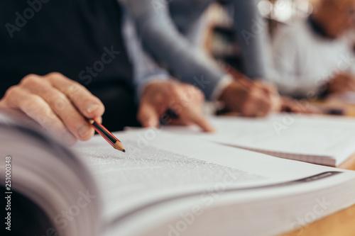 Fototapeta Close up of a person reading a book obraz