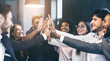 canvas print picture - Happy office workers giving high five at meeting