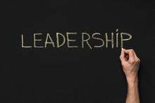 Word Leadership Written With White Chalk On Blackboard
