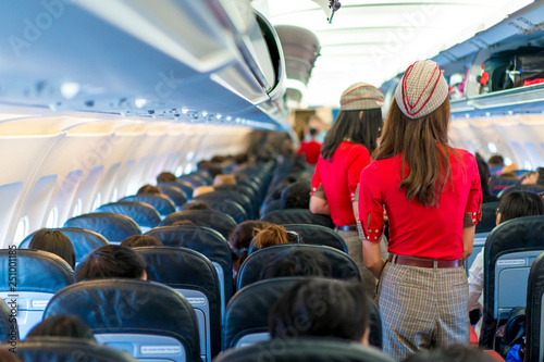 Stampa su Tela air hostess in red uniform services and checks for all correct at all around the
