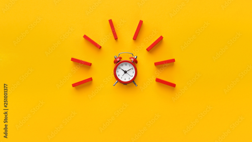 Fototapety, obrazy: Alarm clock with red dominoes on yellow background