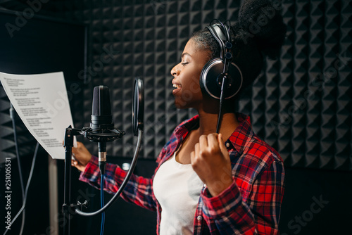 Fotomural Young woman songs in audio recording studio