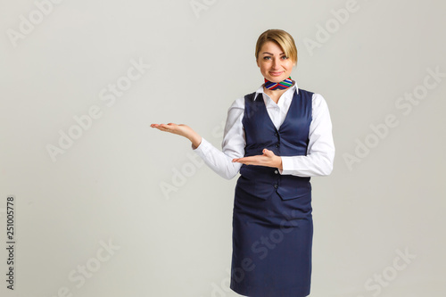 Portrait of charming stewardess wearing in blue uniform Canvas Print
