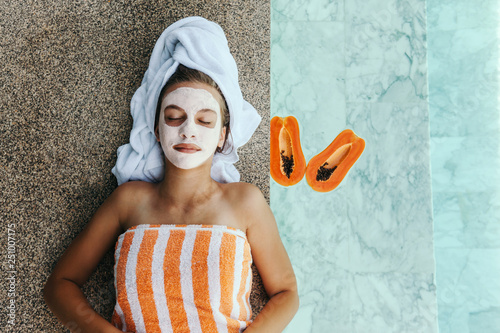 Foto op Canvas Spa Teen girl applying organic fruit facial mask