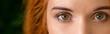 Leinwandbild Motiv Green eyes of young redhead woman panorama