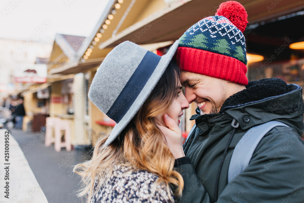 Fototapety, obrazy: Closeup portrait amazing couple in love enjoying time together on street. True lovely emotions, brightful feelings, happiness, christmas time, falling in love.