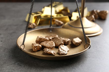 Scale Pan With Gold Lumps On Grey Table, Closeup