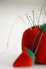 Pins And Sewing Needles In A Pin Cushion