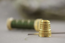 Close Up Of Thimble And Sewing Thread