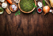 canvas print picture - Ingredients for cooking green lentils with mushrooms and vegetables, spices and herbs, vintage wooden kitchen table, food cooking background, place for text. Vegan or vegetarian food