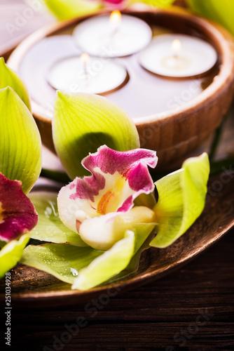 Obraz na plátně  orchid and candles