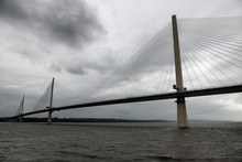 Modern Queensferry Crossing Cable Stayed Suspension Bridge Over The Firth Of Fourth To Edinburgh Scotland UK Under Stormy Gray Sky