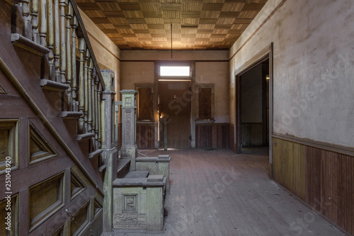 Photo Stands Stairs Parquet ceiling and vintage wooden staircase with large entry way in a beautiful abandoned plantation home